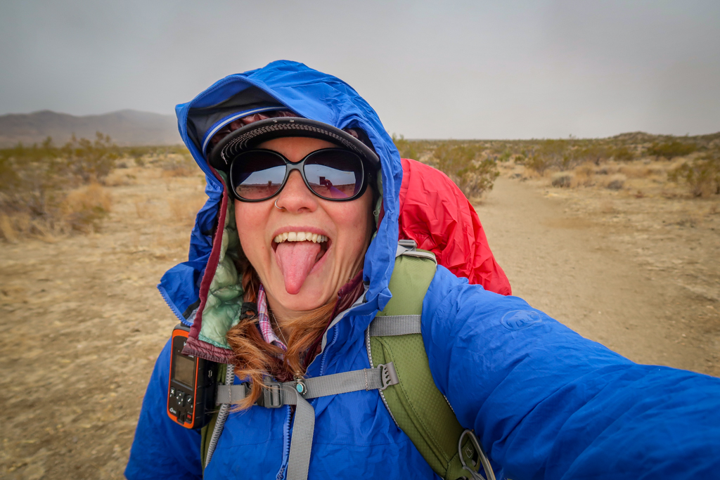 Photo of the author wearing a raincoat with hood over a puffy jacket near the Twin Tanks trailhead
