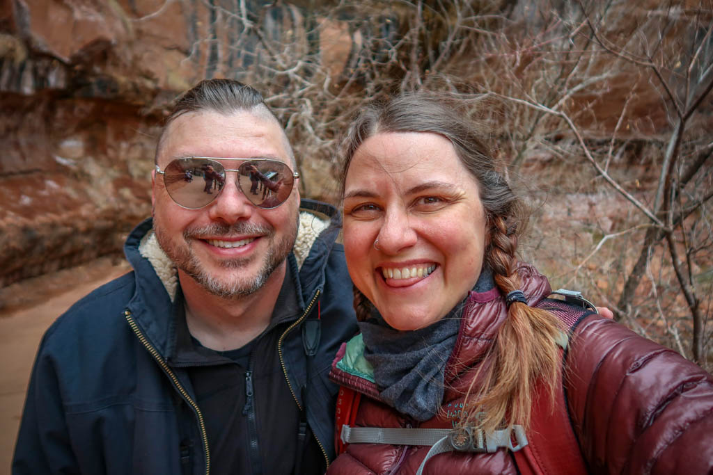 Photo of Daniel and the author standing on the trail by the Lower Emerald Pool in Zion