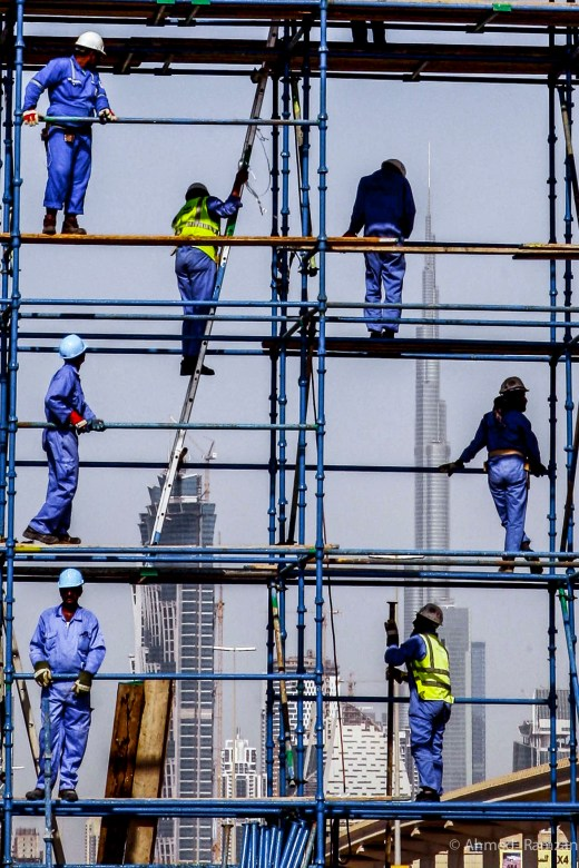Workers erecting the billboad on Shaikh Zayed Road in Dubai. 13th OCTOBER 2011