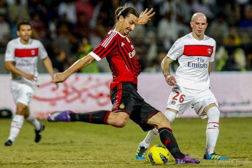 Zlatan Ibrahimovic from AC Milan playing in action against Christophe Jallet from Paris Saint-German, during the Dubai Football Challenge at Al Ahli Club, Dubai. 4th JANUARY 2012
