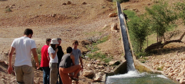 Arava Institute students monitoring the Be'er Sheva stream, which carries sewage and industrial pollution from Palestine into Israel. For legal reasons, Israel can only partially treat this contaminated water before returning it to the stream. (http://arava.org/)