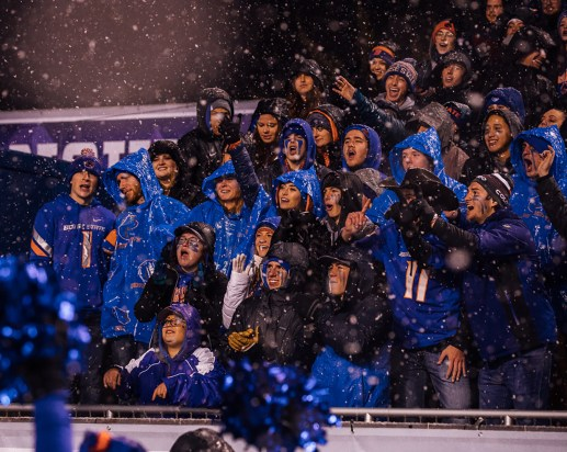 Boise State fans in the student section cheering on the Boise State football team in Albertsons Stadium.