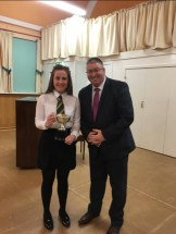 Holly Bennett (under 16) Northern Counties Brass Band Association winner – receiving the trophy from Charlie Farren (Adjudicator) –January 2018