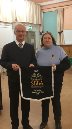Mike getting presented with the Band of the Year banner from Ann Murray (SBBA)
