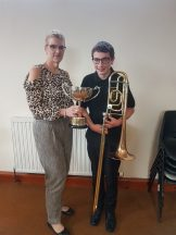 Alix Bailey receiving the Vic Lewis Memorial Trophy from our Band President, Ann Ness