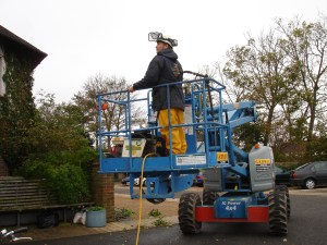 Using heavy machinery to renovate timber cladding at the Sussex Beacon