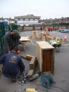 Arbworx team constructing planters from recycled timber