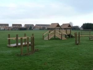 Trim trail playground installation on grass