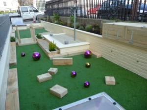 Nursery play area with storage boxes