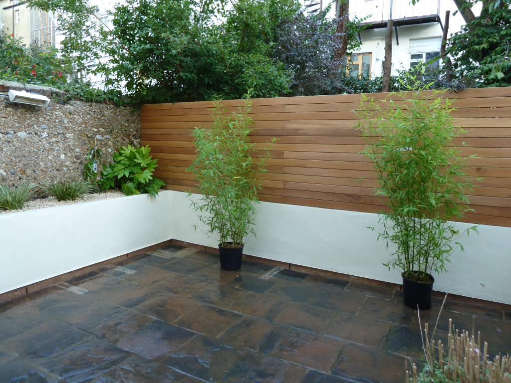 hard wood decking and rendered wall, Hove, East Sussex