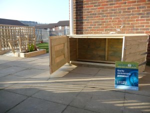 Custom built timber storage solution, new deck, play bridge and artificial turf for a nursery in Brighton