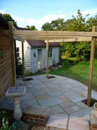 patio with indian sandstone and softwood timber pergola