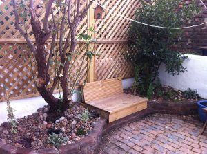 Full garden makeover for a back garden including new paving, retaining walls, seating area and screen