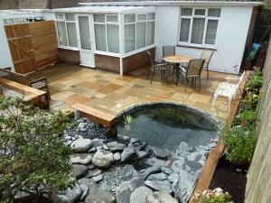 Indian sandstone paving, oak sleepers, garden makeover