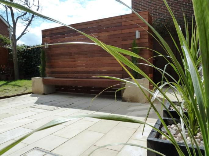 Garden makeover with paving, Ipe hardwood deck, vertical screen and planters (2)