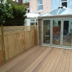 The close board fencing linking up with the deck