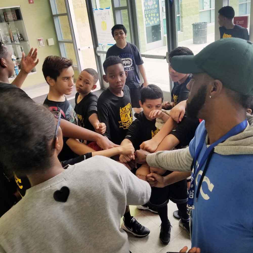 teamwork-huddle-tournament-hands-in