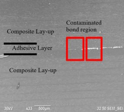SEM image of contamination at bondline.