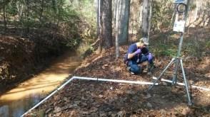 DOE Fellow Juan Morales installing a remote monitoring stations at SRS