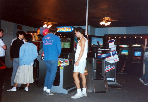 Kids at the arcade in the 1980s via arcadeheroes.com