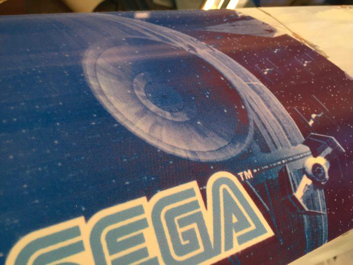 detailed shot of star wars arcade trilogy marquee