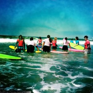 Surf lessons in Huntington Beach, in the water.