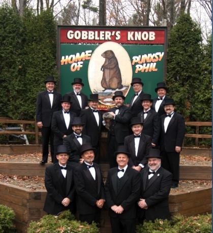 men in top hats with groundhog