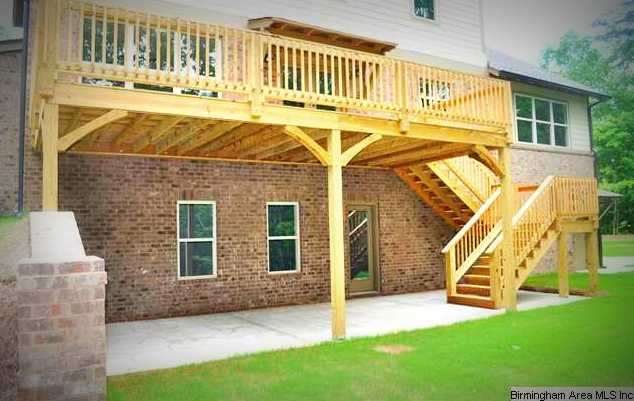 Large patio is underneath the deck from the walk out basement. on Walkout Basement Patio Designs id=58283