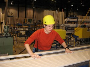An Arcadia Windows and Doors employee works in the company's factory