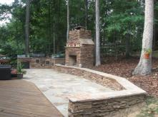 Archadeck designed this outdoor fireplace and outdoor kitchen and patio