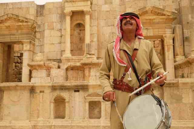 Traditional musicians entertain travelers at Jerash, demonstrating the spectacular acoustics in the amphitheatre. Photo: Genevieve Hathaway Photography.