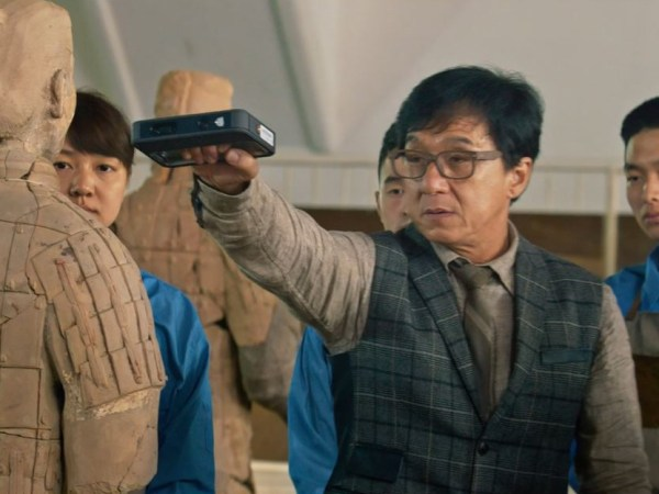 Jackie Chan scans a statue (Film: Kung Fu Yoga)