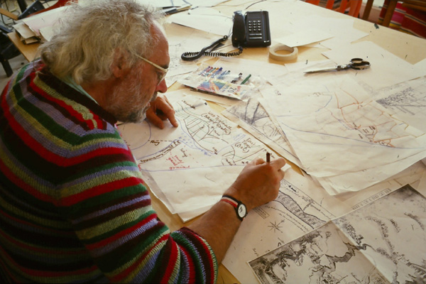Mick Aston at a desk working through historic maps
