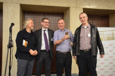 Prof Chris Stringer of the Natural History Museum (2nd from R) and Dr Simon Lewis of Queen Mary, University of London (R) accept the 2015 Current Archaeology Award for Rescue Dig of the Year (sponsored by Export and General Insurance Services), on behalf of the Happisburgh Project.