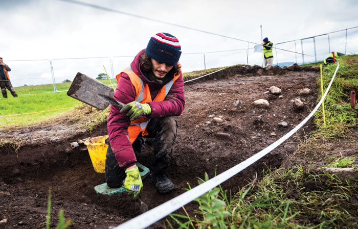 An archaeologist excavating a Bronze Age monument at Carrowmore