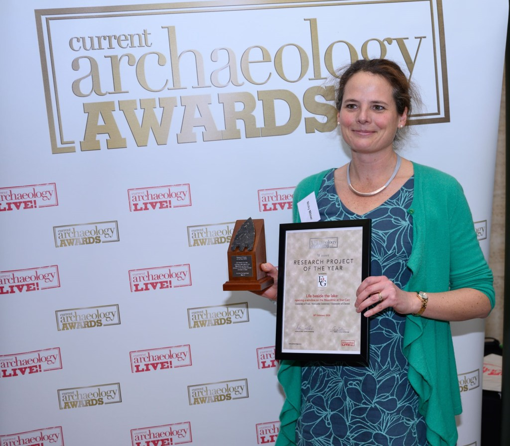 Nicky Milner from the University of York collects the award for Research Project of the Year 2020 at the Current Archaeology Awards. [Photo credit: Adam Stanford, Aerial-Cam]