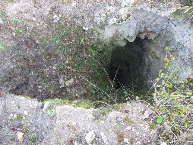 A treasure hunting pit on the spot of the Slavnata Kanara (Glorious Rock) Fortress in Northeast Bulgaria; some of the pits dug up by treasure hunters reach up to 10 meters in depth. Photo: Dobrich Online
