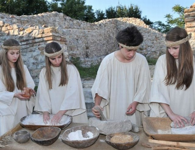 Teenage performers reenact an Ancient Thracian bread-making ritual during the historical reenactment at the ancient fortress Montanesium in Bulgaria's Montana. Photo: Standart Daily