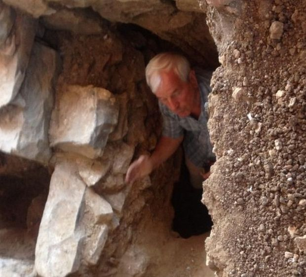 Archaeologist Kazimir Popkonstantinov at the entrance of the newly found Early Christian tomb of a senior clergyman in the St. John the Baptist Monastery on St. Ivan (St. John) Island in the Black Sea, off the coast of Bulgaria's Sozopol where in 2010 he found relics of St. John the Baptist. Photo: Darik Burgas