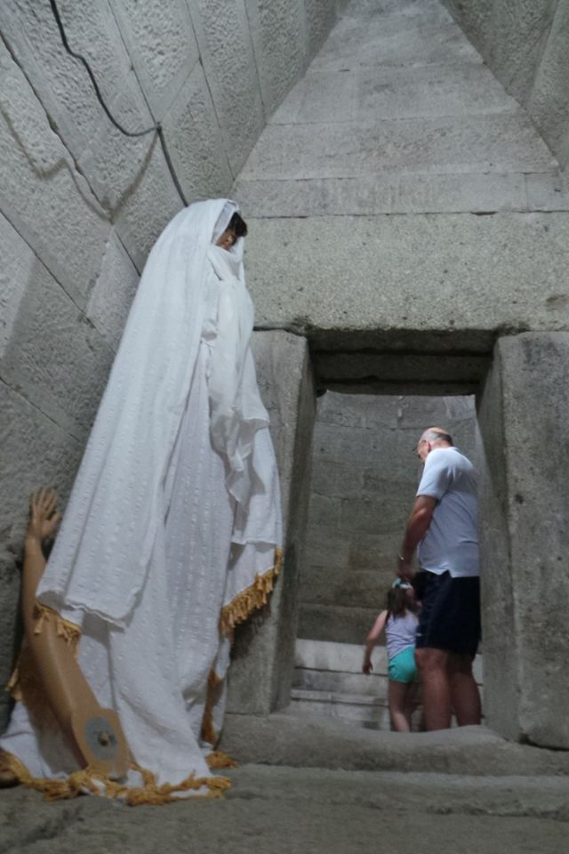 A creepy, kitsch, and historically irrelevant large plastic figure of a woman dressed in white scares off visitors of the Ancient Thracian tomb in Mezek, Bulgaria, giving them headbumps. Photo: Stariyat Most