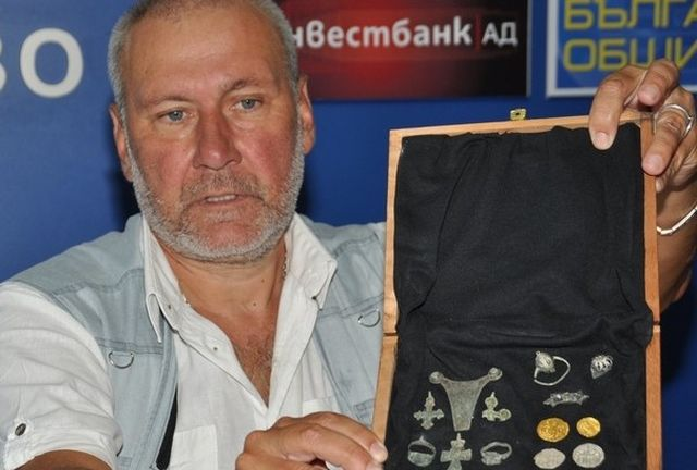 Archaeologist Nikolay Ovcharov shows some of the other archaeological artifacts, including 14th century gold and silver coins, discovered during the 2015 summer excavations at the ancient and medieval rock city of Perperikon. Photo: Darik Haskovo