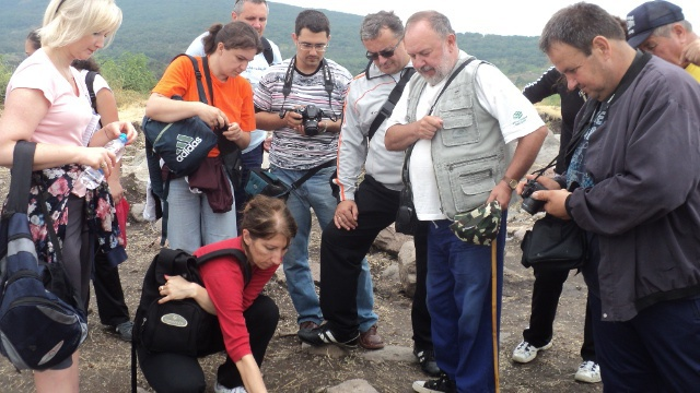 Assoc. Prof. Ivan Dzhambov (center) showing to reporters the excavations of the Late Antiquity Fortress near Bulgaria's Dragoynovo. Photo: Radio Plovdiv