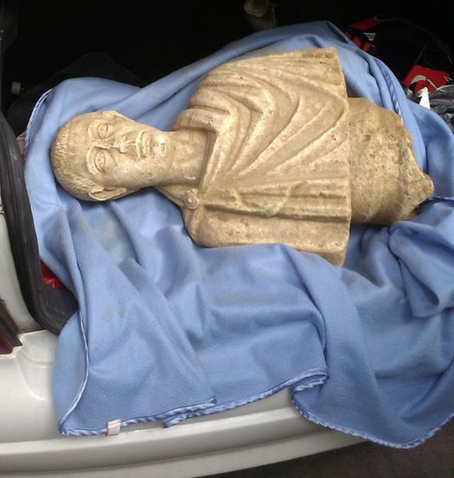 The seized bust of Roman Emperor Gordian III is pictured here inside the trunk of the trafficker's car. Photo: Bulgaria's Interior Ministry