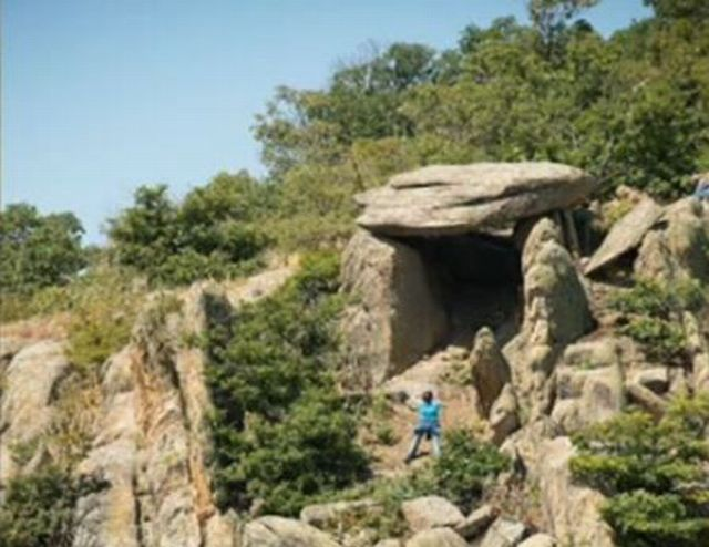 "The newly discovered dolmen - a prehistoric or early ancient single-chamber stone tomb - near Zlatosel in the Sredna Gora Mountain in Southern Bulgaria. It is said to be the largest dolmen found in Bulgaria to date, the size of a ""two-room apartment"". Photo: TV grab from BNT"