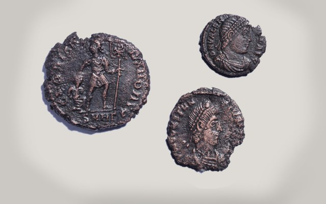 A total of 26 4th century Roman bronze coins were found in one of the three graves. Photo: PressTV