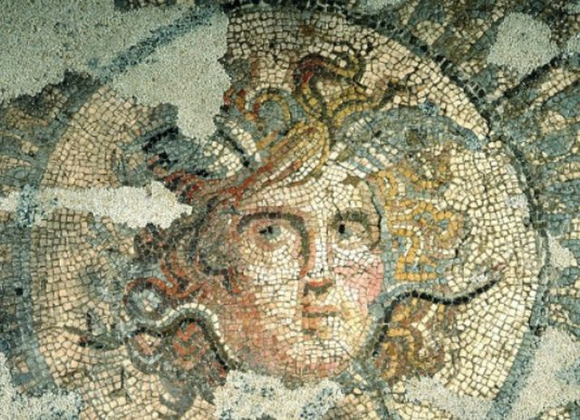 The mosaic image of gorgon Medusa, early 4th century AD, exhibited in situ in the Museum of Roman Mosaics of ancient Marcianopolis (Marcianople) in Bulgaria's Devnya is not frightening and is interpreted as a talisman protecting the home. Photo: Devnya Municipality