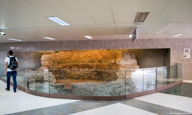 The curved apse of an early Christian basilica is exhibited in situ at the northern entrance of the Serdica II Metro Station in Sofia. Photo: Archaeology Travel