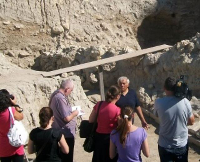 Lead archaeologist Vasil Nikolov showing reporters around the Salt Pit prehistoric settlement near Bulgaria's Provadiya. Photo: Trud daily