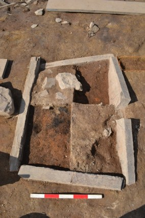 Figure 3: A multi-layered hearth from the SW side of structure 14, Ness of Brodgar (Nick Card)