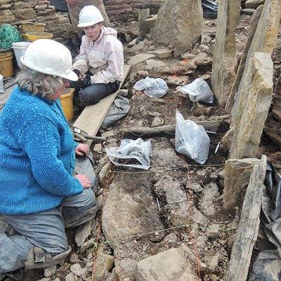 Val-and-Helen-excavating-inside-the-broch-using-a-floor-sampling-grid